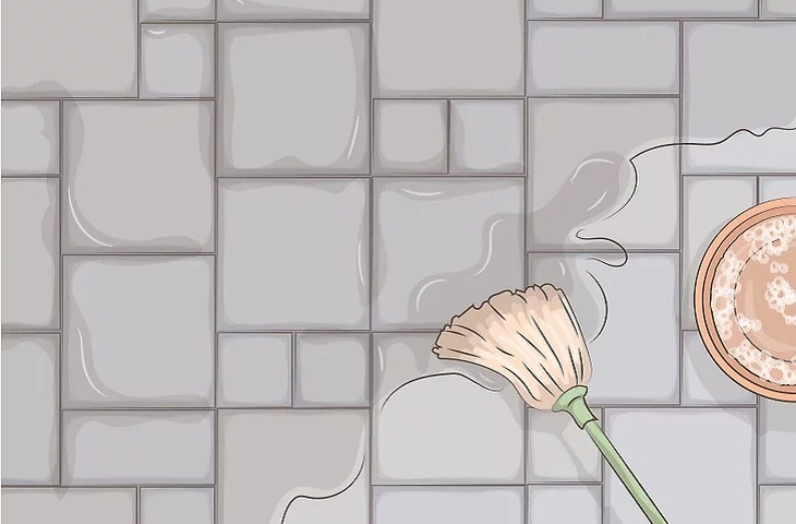 Lau toàn bộ sàn bê tông bằng dung dịch vệ sinh.