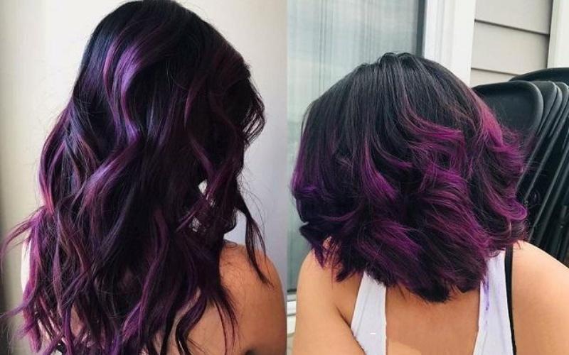 Mái tóc nhuộm highlight tím đậm trên nền đen