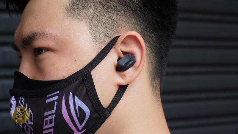 Belkin headphones on hand