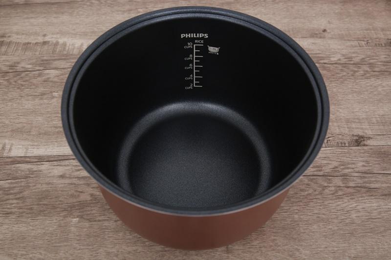Lòng nồi bằng chất liệu hợp kim nhôm tráng men chống dính - Nồi cơm điện Philips 1.8 lít HD3115
