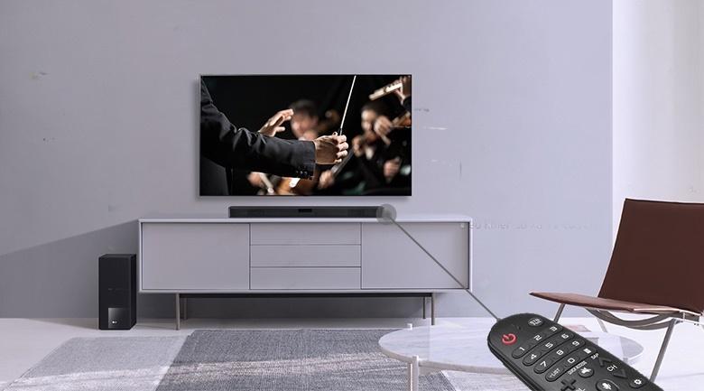 Có remote điều khiển từ xa dễ thao tác, tùy chỉnh chức năng trên loa - Dàn âm thanh LG 4.1 SL5R 520W