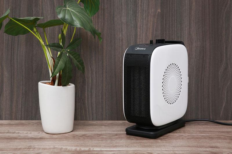 Màu trắng đen đơn giản, sang trọng, thiết kế gọn đẹp - Quạt sưởi nhiệt Midea MH-P15-C
