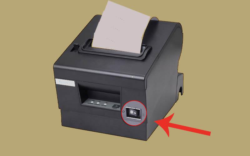 Ấn vào nút nguồn của máy in để khởi động máy
