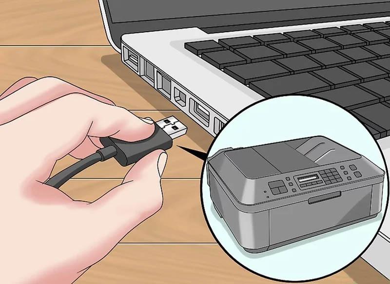 Bước 2: Kết nối máy in với máy tính bằng cách gắn dây cáp USB vào cổng USB trên thân máy tính